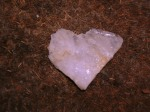Photo of a heart-shaped crystal rock