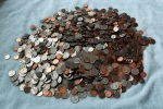 Photo of US coinds in a pile - quarters, dimes, nickels, pennies
