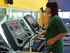 Photo of a woman working out on a treadmill